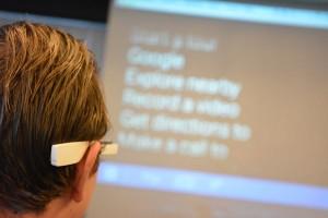 workshop deelnemers kijken mee op groot scherm